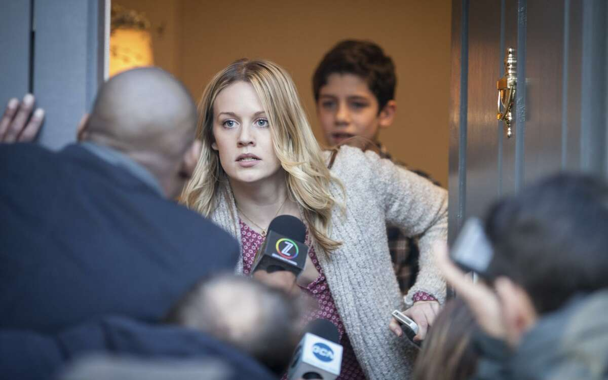 Cara Theobold plays a woman who marries an FBI agent after his wife disappears, and is raising his son (Patrick McAuley).