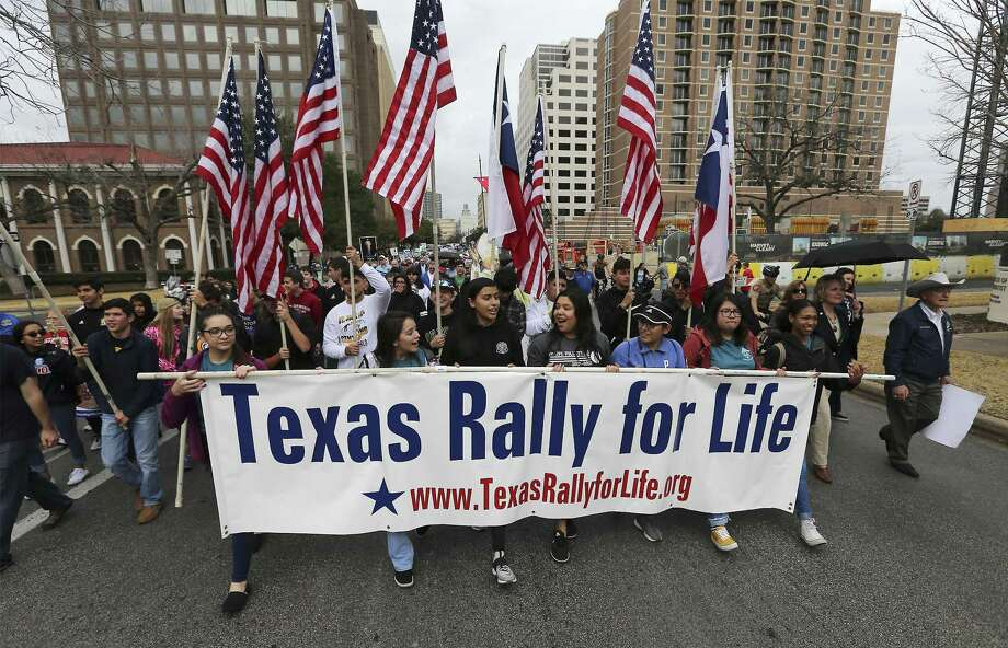 The Texas Rally for Life brought a large crowd to march and gather at the Texas Capitol where they heard Texas Gov. Greg Abbott support pro-life and laws that benefit pro-life in Austin on Saturday, Jan. 27, 2018.  (Kin Man Hui/San Antonio Express-News) Photo: Kin Man Hui, Staff / San Antonio Express-News / ©2018 San Antonio Express-News