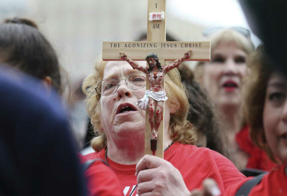 Elizabeth Jimenez of Georgetown carries a wooden cross of Christ as she attends The Texas Rally for Life which brought a large crowd to march and gather at the Texas Capitol where they heard Texas Gov. Greg Abbott support pro-life and laws that benefit pro-life in Austin on Saturday, Jan. 27, 2018. (Kin Man Hui/San Antonio Express-News)