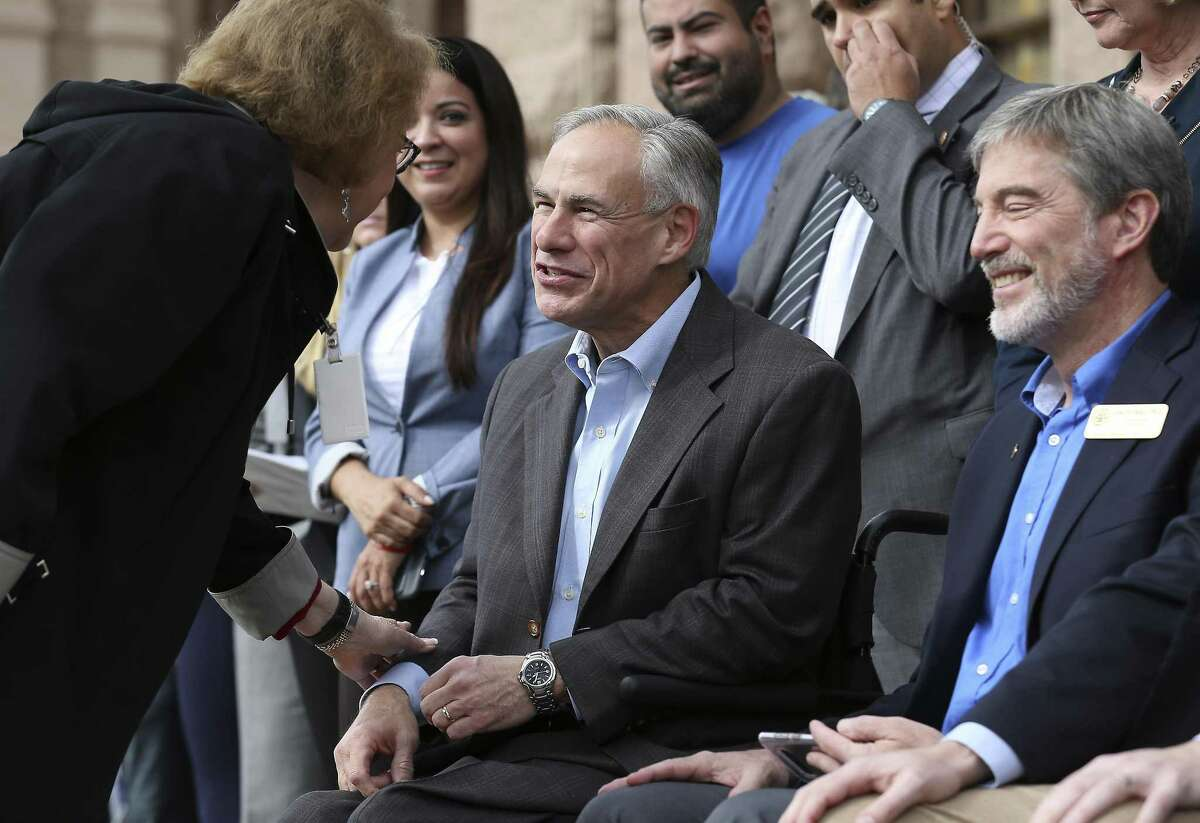Texas Gov. Greg Abbott greets a guest at The Texas Rally for Life which brought a large crowd to march and gather at the Texas Capitol where they heard Abbott support pro-life and laws that benefit pro-life in Austin on Saturday, Jan. 27, 2018. (Kin Man Hui/San Antonio Express-News)