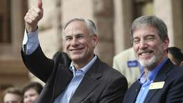 Texas Gov. Greg Abbott (left) gestures to someone in the crowd at The Texas Rally for Life which brought a large audience to march and gather at the Texas Capitol where they heard Abbott support pro-life and laws that benefit pro-life in Austin on Saturday, Jan. 27, 2018.  (Kin Man Hui/San Antonio Express-News)