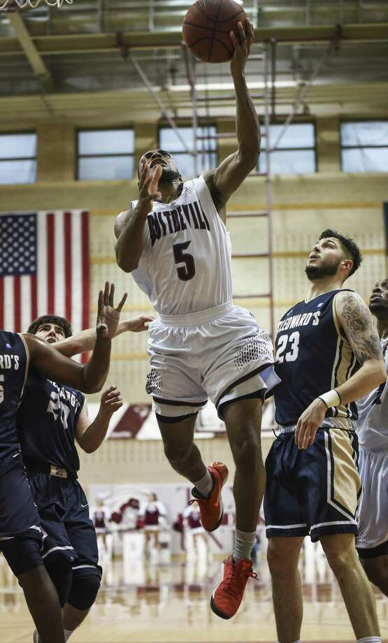 Senior point guard Jeremy Wright led the Dustdevils to their first league win of the season in their last game of the first round of Heartland Conference play. Wright had 15 points and eight assists as the team won without injured senior Dan Milota. Photo: Danny Zaragoza /Laredo Morning Times