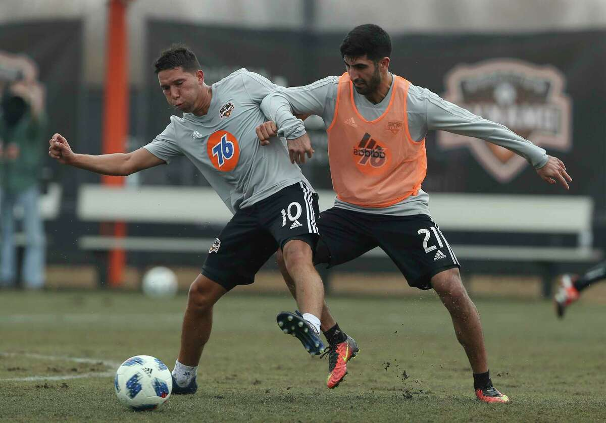 The Dynamo's Tomas Martinez, left, battles defender George Malki for possession during practice Saturday. Fans got to see Martinez, the Argentine playmaking midfielder, during an open workout at Houston Sports Park.