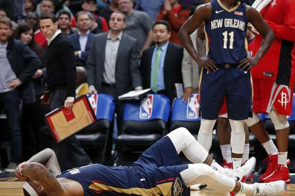 New Orleans' DeMarcus Cousins lies on the court after injuring his left Achilles tendon. The All-Star center averages more assists than some of the league's point guards.