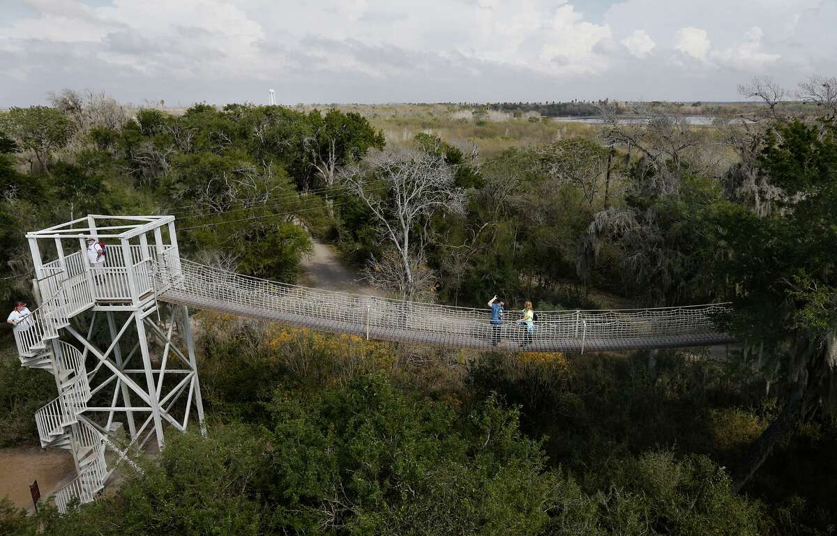 People take in the sights from the canopy bridge at the Santa Ana National Wildlife Refuge Saturday Jan. 27, 2018 in Alamo, Tx.