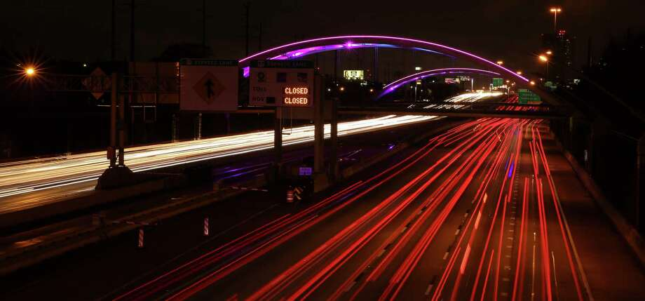Lights are turned back on bridges over the Southwest Freeway in Montrose at sunset on Saturday, Jan. 27, 2018, in Houston. The lights were turned off on January 19 because the Montrose Management District  could not pay the utility bill while under a temporary court order. Photo: Yi-Chin Lee, Houston Chronicle / © 2018  Houston Chronicle