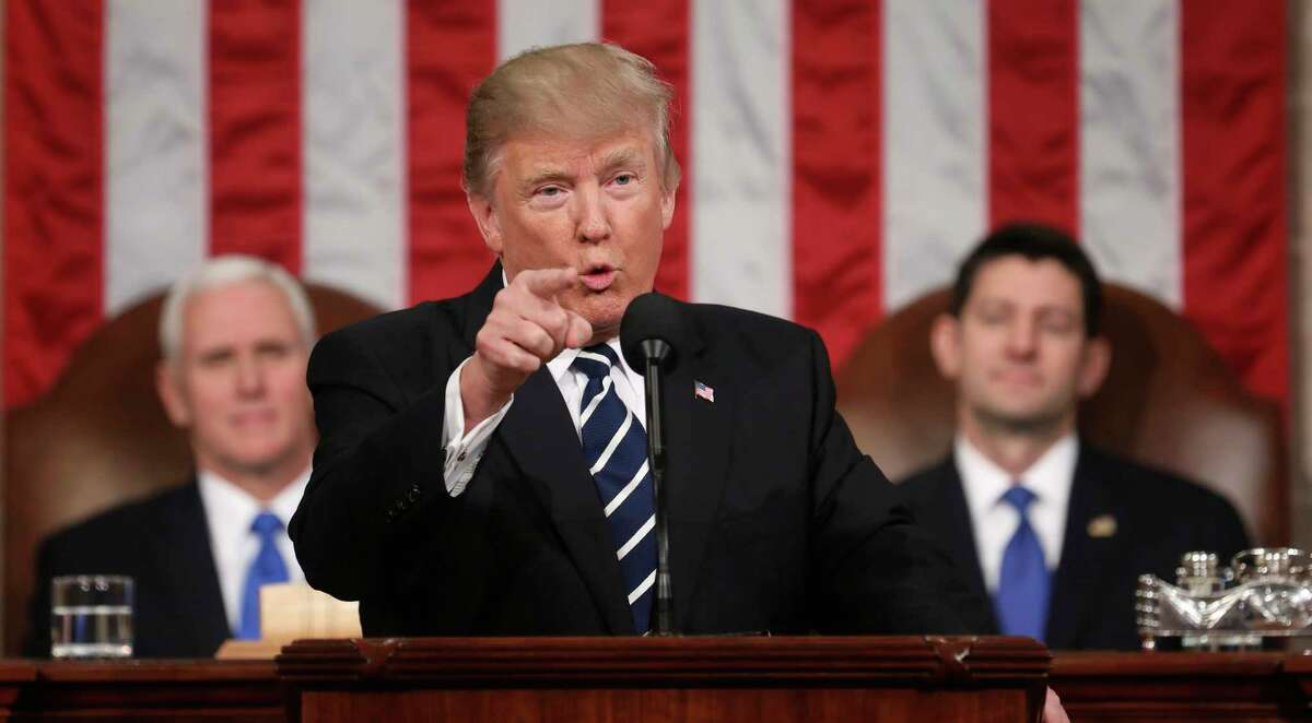 FILE - In this Feb. 28, 2017, file photo, President Donald Trump addresses a joint session of Congress on Capitol Hill in Washington. as Vice President Mike Pence and House Speaker Paul Ryan of Wis. listen. Trump will deliver his first State of the Union address on Tuesday, Jan. 30, 2018. (Jim Lo Scalzo/Pool Image via AP, File)