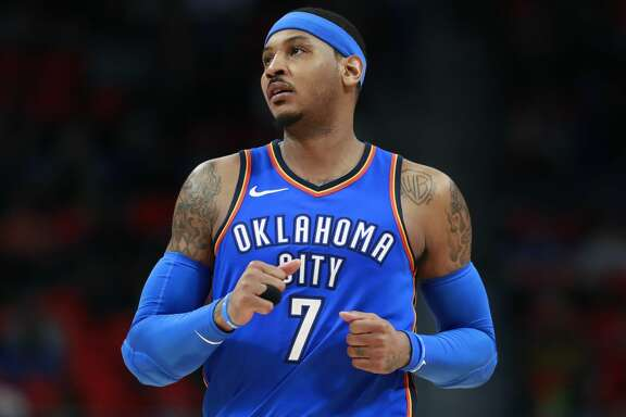 Oklahoma City Thunder forward Carmelo Anthony runs up court during the second half of an NBA basketball game against the Detroit Pistons, Saturday, Jan. 27, 2018, in Detroit. (AP Photo/Carlos Osorio)