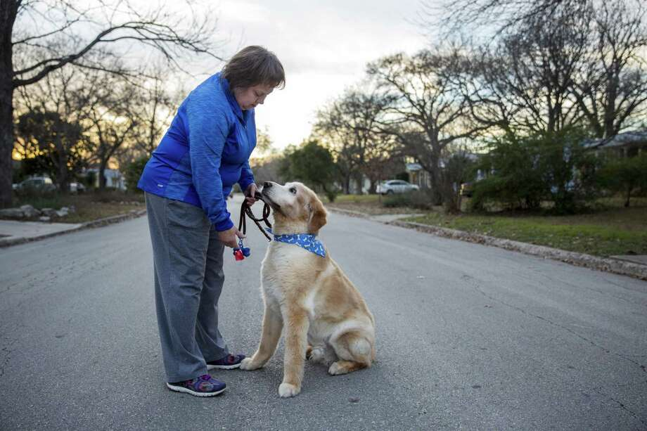 Becky Snodgrass remembers a time when she and her dog Sampson, were also attacked by a neighbor's dog. Now, Snodgrass carries a knife when she walks Sampson. Photo: R. Tomas Gonzalez / For The San Antonio Express-News / R. Tomas Gonzalez