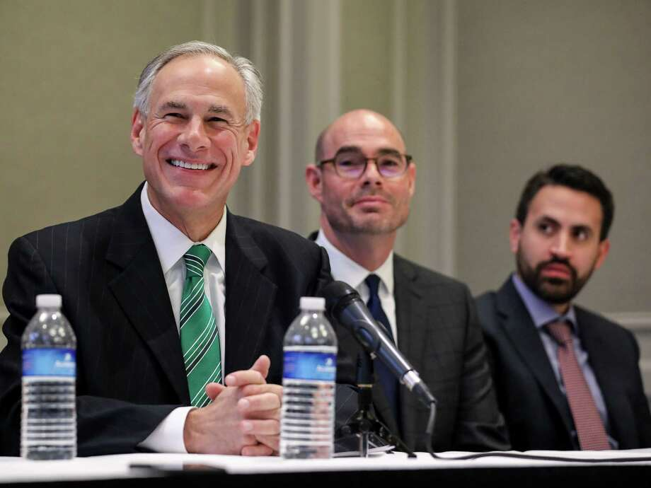 Governor Greg Abbott, from left, state Rep. Dennis Bonnen and David Garcia, a Harris County homeowner, are seen during a press conference about a new property tax proposal, at the Westin Galleria hotel, Tuesday, Jan. 16, 2018, in Houston.  ( Jon Shapley / Houston Chronicle ) Photo: Jon Shapley, Houston Chronicle / © 2017 Houston Chronicle