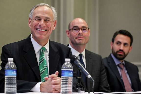 Governor Greg Abbott, from left, state Rep. Dennis Bonnen and David Garcia, a Harris County homeowner, are seen during a press conference about a new property tax proposal, at the Westin Galleria hotel, Tuesday, Jan. 16, 2018, in Houston.  ( Jon Shapley / Houston Chronicle )