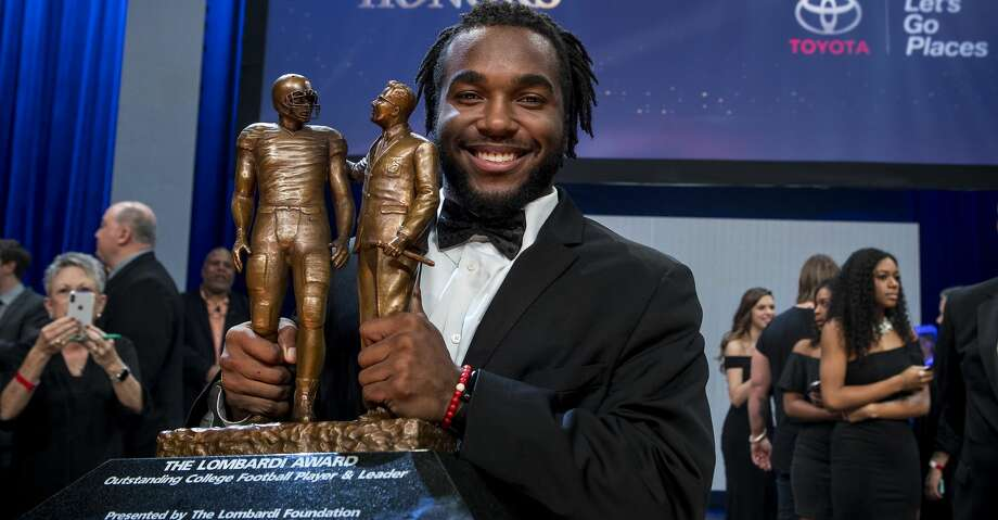 Stanford University junior running back Bryce Love poses for photos with the Lombardi Award trophy at Long Star College Cy Fair on Saturday, Jan. 27, 2018, in Cypress, Texas. The annual award recognizes an NCAA Division I player, regardless of position, based on performance, leadership, character, and resiliency. ( Brett Coomer / Houston Chronicle ) Photo: Brett Coomer/Houston Chronicle