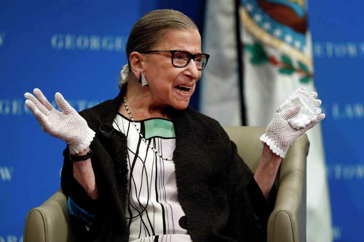 In this Sept. 20, 2017, file photo, U.S. Supreme Court Justice Ruth Bader Ginsburg reacts to applause as she is introduced by William Treanor, Dean and Executive Vice President of Georgetown University Law Center, at the Georgetown University Law Center campus in Washington. In different circumstances, Ginsburg might be on a valedictory tour in her final months on the Supreme Court. But in the era of Donald Trump, the 84-year-old Ginsburg is packing her schedule and sending signals she intends to keep her seat on the bench for years.(AP Photo/Carolyn Kaster, File)