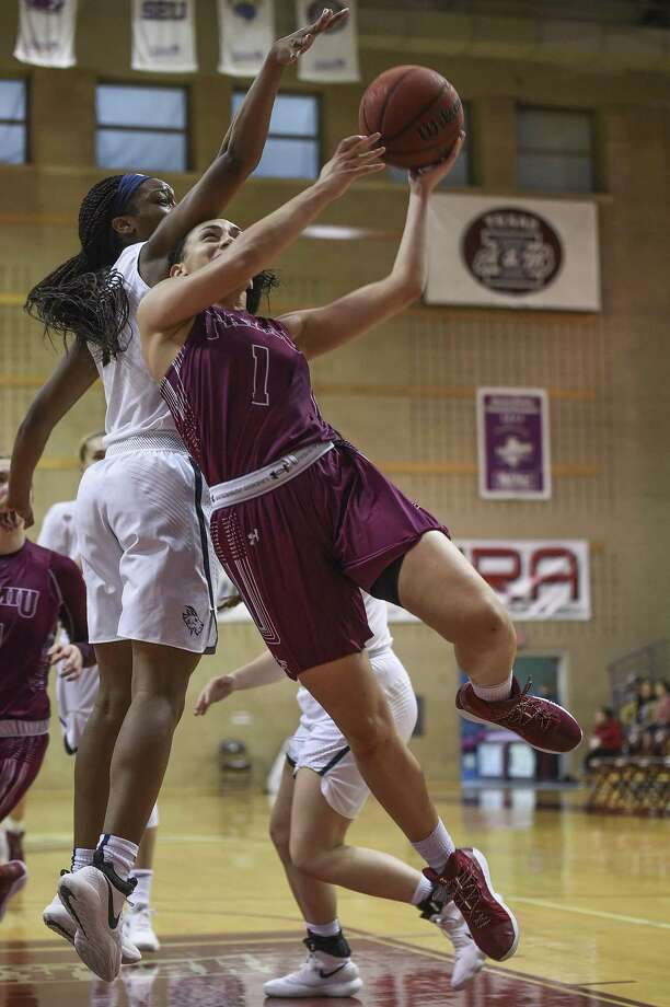 Tantashea Giger scored 14 points and grabbed a career-high 12 rebounds Saturday in a TAMIU loss to St. Edward's. The Dustdevils have now dropped 11 straight and are 2-19 this season. Photo: Danny Zaragoza /Laredo Morning Times