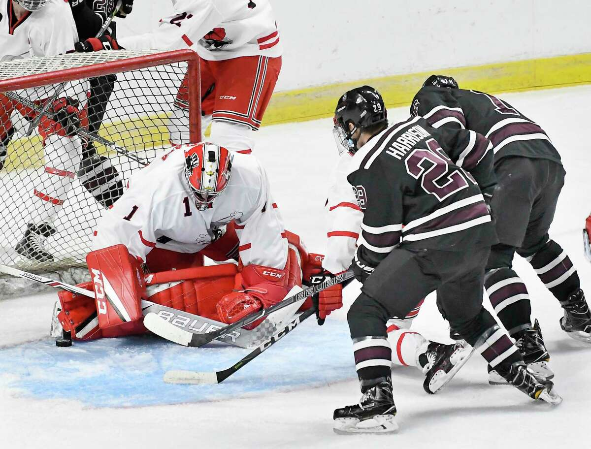 Union's forward Parker Foo (28) scores against Rensselaer Polytechnic Institute goaltender Linden Marshall (1) during the first period of an NCAA college hockey game Saturday, Jan. 27, 2018, in Albany, N.Y., (Hans Pennink / Special to the Times Union)