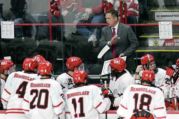 Rensselaer Polytechnic Institute head coach Dave Smith instructs his players against Union during the first period of an NCAA college hockey game Saturday, Jan. 27, 2018, in Albany, N.Y., (Hans Pennink / Special to the Times Union)