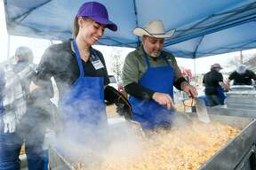 Diana Pritchard (left) and Roger Martinez with Jacobs prepare chorizo & egg for tacos during the Second Annual Bexar County Rodeo Breakfast in the BiblioTech parking lot at 3005 Pleasanton Road on Saturday, Jan. 27, 2018. The crowd enjoyed free tacos, educational displays, family activities and live music at the event, the South Side's way to kick of the San Antonio Stock Show & Rodeo festivities. MARVIN PFEIFFER/mpfeiffer@express-news.net