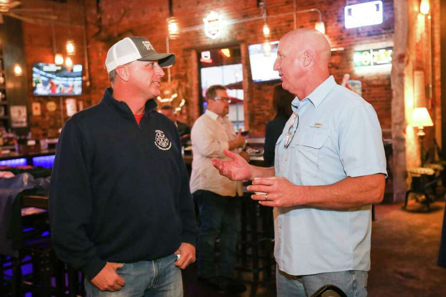 Lloyd Sandefer, Conroe Professional Firefighters Association President, left, and Conroe Fire Chief Ken Kreger, right, chat during a pancake breakfast and book signing fundraiser for PTSD awareness on Saturday at Pacific Yard House in Conroe. Photo: Michael Minasi, Staff Photographer / © 2017 Houston Chronicle
