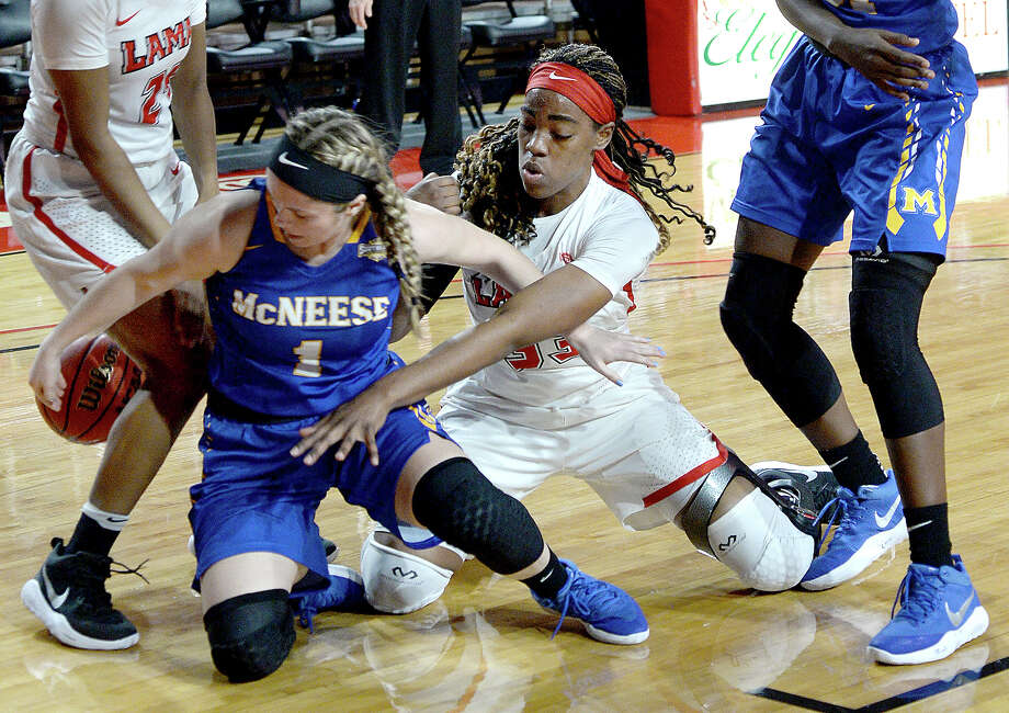 Lamar's Kiandra Bowers battles with McNeese's Reagan Bolton for control of the loose ball during their game at the Montagne Center Saturday. Photo taken Saturday, January 27, 2018 Kim Brent/The Enterprise Photo: Kim Brent / BEN