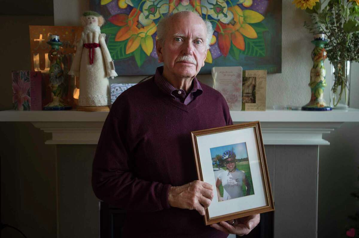 """John Beerman, holding a picture of his deceased daughter, Theresa, is concerned with Texas gun laws after Theresa bought a firearm and committed suicide in December. """"She had a history of mental illness in Montgomery County and Colorado Springs,"""" he said. """"I don't think she knew what she was doing; I think she didn't realize the permanency of her decision. Her mind wasn't right."""" After speaking with the gun shop, he still can't believe that she was able to obtain a gun with her record."""