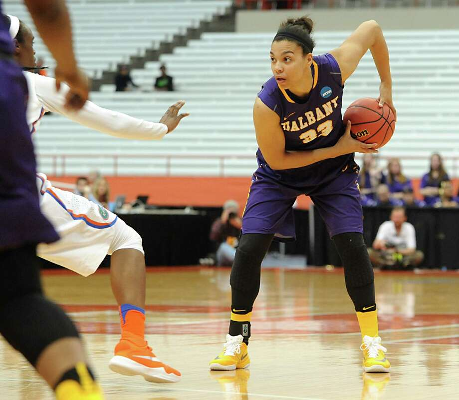 University at Albany's Tiana-Jo Carter looks for an open player during a match against Florida in the first round of the NCAA women's basketball tournament at the Carrier Dome on Friday, March 18, 2016 in Syracuse, N.Y.  (Lori Van Buren / Times Union) Photo: Lori Van Buren