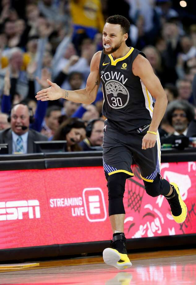 4923cfcaca6a Golden State Warriors  Stephen Curry celebrates a 3-pointer in 2nd quarter  against Boston