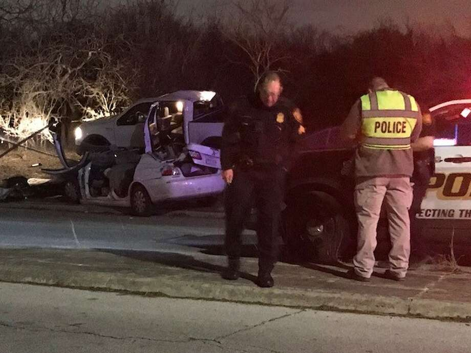 San Antonio police say a woman had to be cut from her vehicle following a wreck on the East Side, Saturday, Jan. 27, 2018. The two drivers involved in the wreck were taken to Brooke Army Medical Center with injuries that were not life-threatening. Photo: Alexandro M. Luna
