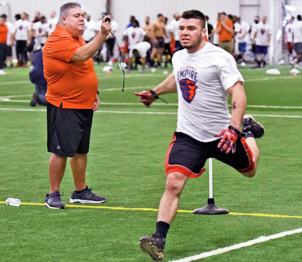 Albany Empire's assistant head coach Les Moss, left, times Jon Milkiewicz of Averill Park in a 40 yd. sprint during tryouts for their new Arena Football League team at Sportsplex Saturday Jan. 27, 2018 in Halfmoon, NY. (John Carl D'Annibale/Times Union)