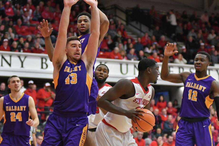 UAlbany's Greig Stire (43) and Devonte Campbell (12) surround a Stony Brook player during their game on Saturday, Jan. 27, 2018. (Jim Harrison / Stony Brook Athletics) Photo: Jim Harrison / Image Habitat, In / 2017  |  Jim Harrison / Stony Brook Athletics