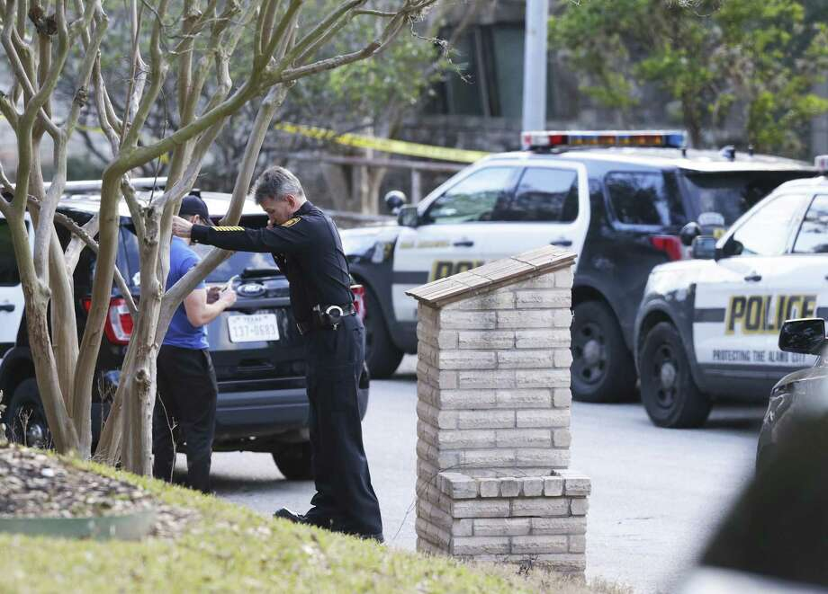 Chief William McManus leans on a tree while taking a call as police investigate the sene of an officer involved shooting on Bluff Circle  on January 27, 2018. Photo: Tom Reel, Staff / San Antonio Express-News / 2017 SAN ANTONIO EXPRESS-NEWS
