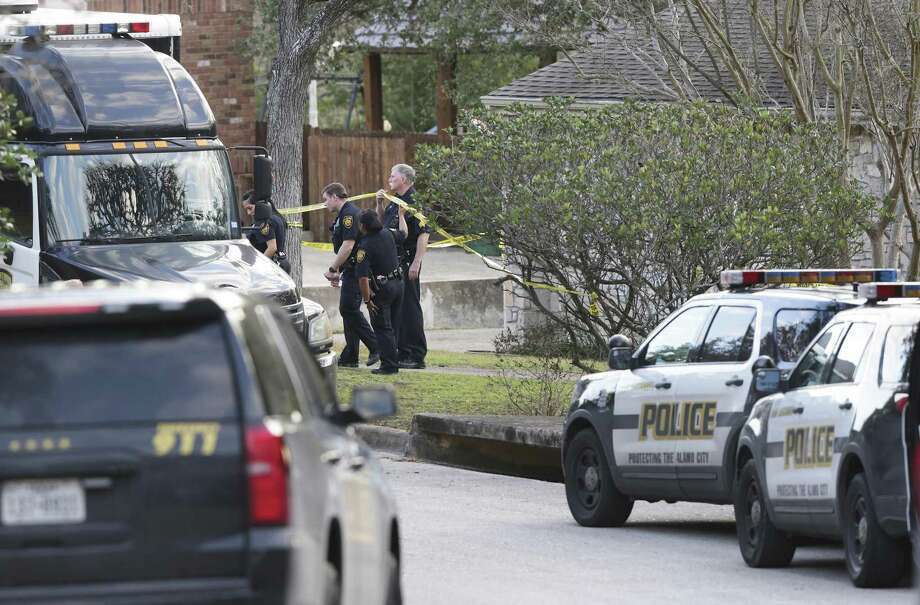 FILE — Police investigate the scene of an officer-involved shooting on Bluff Circle  on January 27, 2018. A San Antonio police officer was suspended for a week for her handling of the incident, a welfare check call that resulted in the death of a mentally ill woman. Photo: Tom Reel, Staff / San Antonio Express-News / 2017 SAN ANTONIO EXPRESS-NEWS
