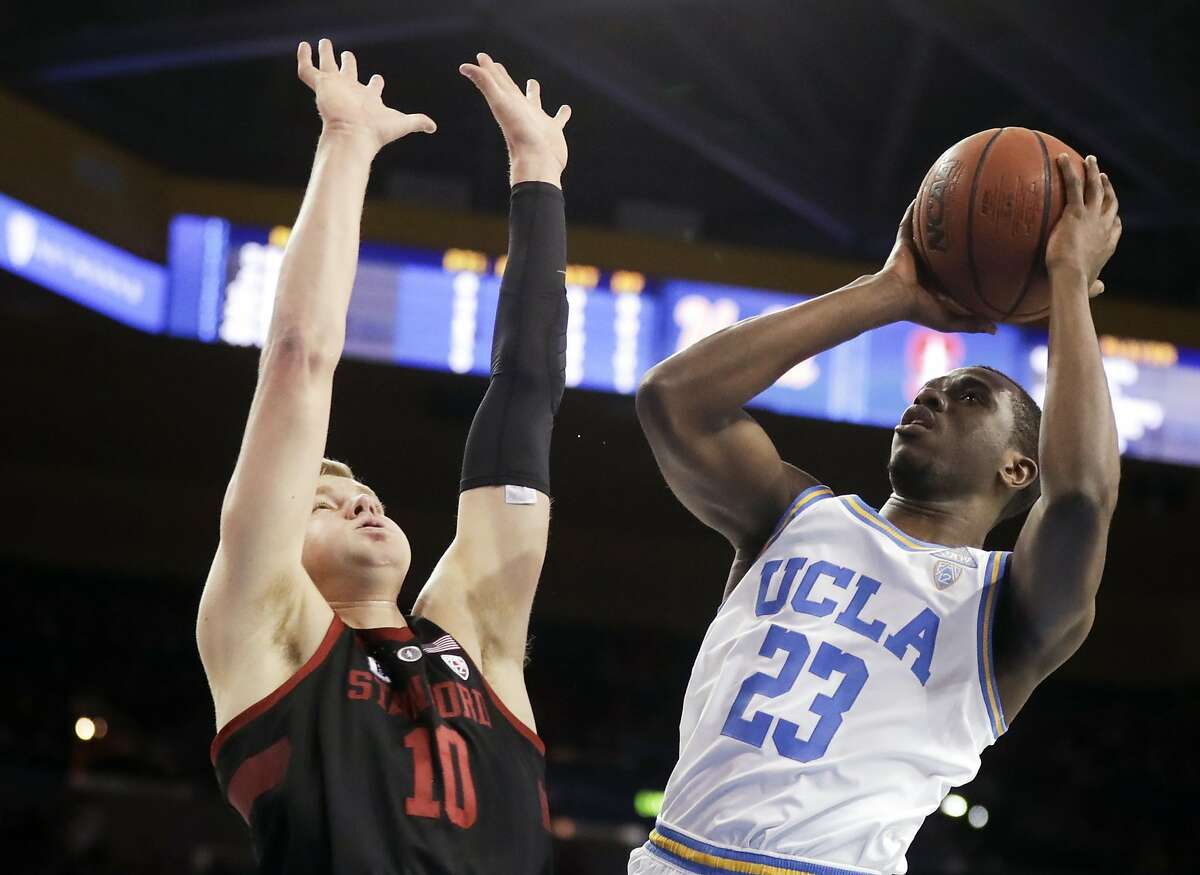 UCLA guard Prince Ali, right, shoots over Stanford forward Michael Humphrey during the first half of an NCAA college basketball game in Los Angeles, Saturday, Jan. 27, 2018. (AP Photo/Chris Carlson)