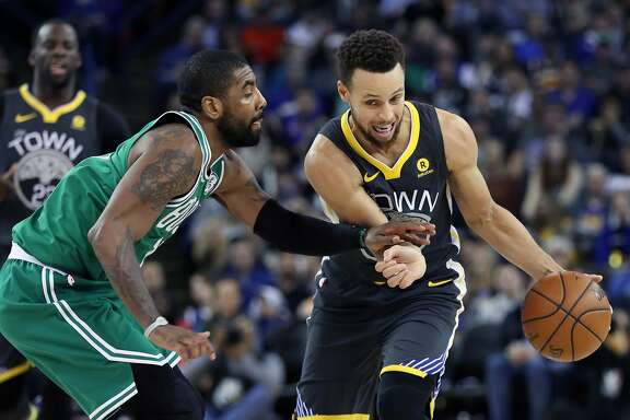Golden State Warriors' Stephen Curry drives against Boston Celtics' Kyrie Irving in 3rd quarter during Warriors' 109-105 win in NBA game at Oracle Arena in Oakland, Calif., on Saturday, January 27, 2018.