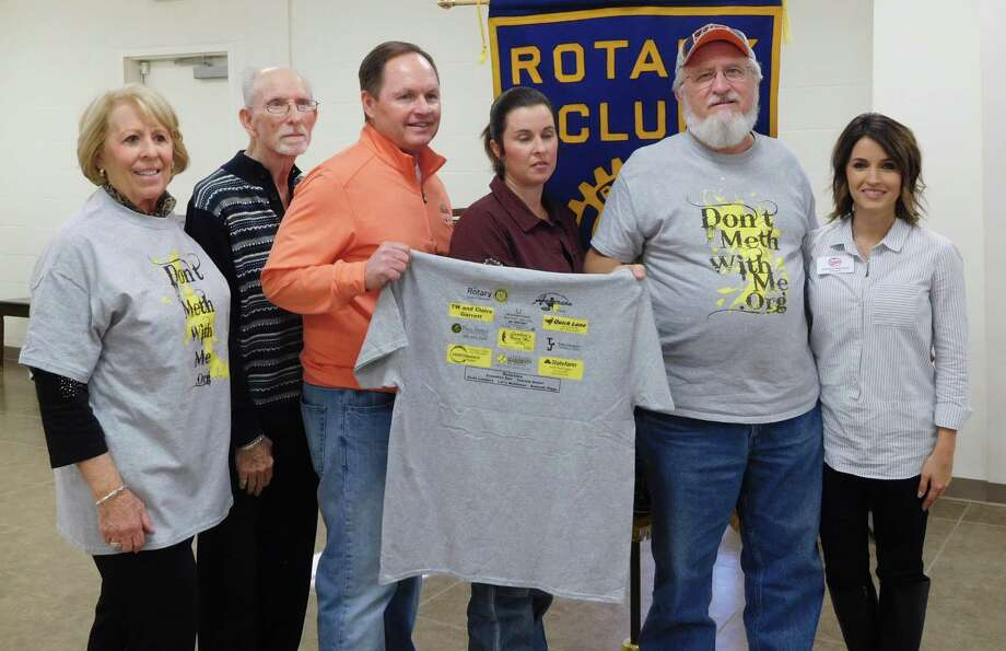 Two important programs were discussed during the Jan. 24 noon luncheon of the Cleveland Rotary Club. Pictured left to right are Rotarians Ernestine Belt and Tommie Daniel, Rotary President Scott Lambert, Rotarian and Don't Meth Program Emcee Amanda Brooks, Rotarian and Program Host Larry Middleton (including one of the T-shirts with sponsor names given to all participants), and ACE Founder and President Ashley Watson. Photo: Submitted