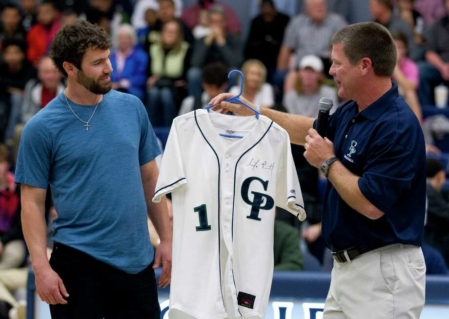 College Park head coach Jason Washburn presents Tampa Bay Rays pitcher Austin Pruitt with a jersey as his number is retired during a ceremony for the former College Park pitcher at College Park High School, Friday, Jan. 26, 2018, in The Woodlands. Photo: Jason Fochtman, Staff Photographer / © 2018 Houston Chronicle