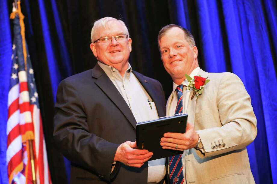 Matt Davis, outgoing Chairman of the Conroe/Lake Conroe Chamber of Commerce, inducts Don Buckalew, Jr. into the Wall of Honor during the Chairman's Awards Gala on Saturday, Jan. 27, 2018, at La Torretta Lake Resort and Spa. Photo: Michael Minasi, Staff Photographer / © 2017 Houston Chronicle