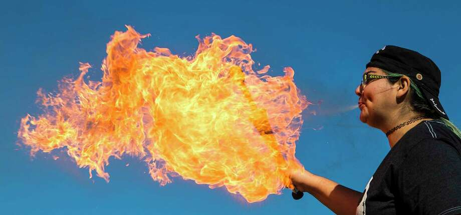 Leslie Barnes spits out a ball of fire as she participates in a an Intro to Fire Breathing with Jandro Fuego class at The Interchange on Sunday, Jan. 14, 2018, in Houston.  The class is part of a 4 class Fire Manipulation Mastery series designed to make participants effective fire manipulators. Whether that is used for self expression, art, personal growth, interest, or entertainment, learning the best practices to best avoid and reduce hazards and catastrophic incidents while participating in this dangerous art. Photo: Brett Coomer, Houston Chronicle / © 2018 Houston Chronicle