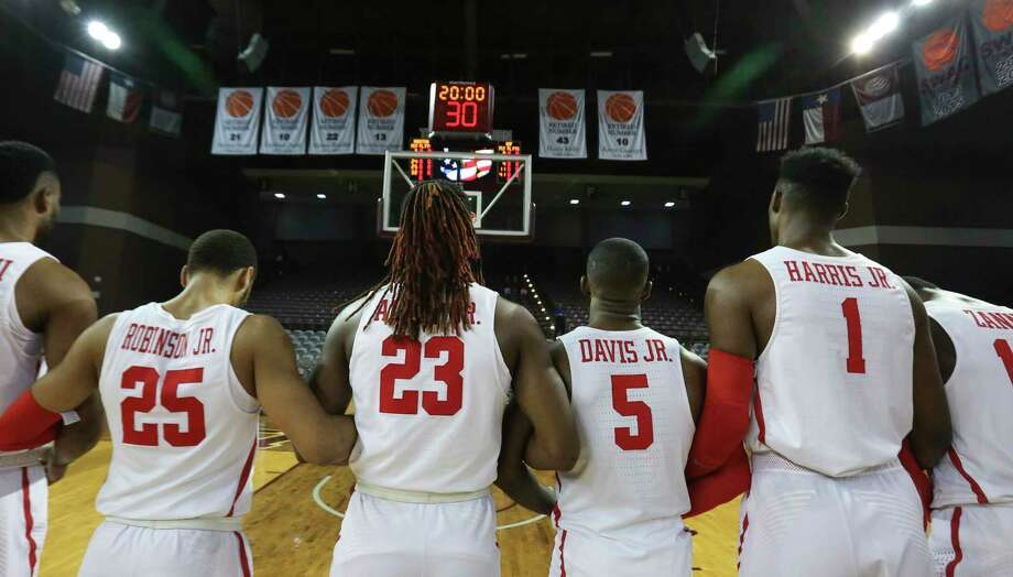 Houston Cougars players Galen Robinson Jr. (25), Cedrick Alley Jr (23), Corey Davis Jr. (5) and Chris Harris Jr. (1) lock their arms during National Anthem before the American Athletic Conference game against the South Florida Bulls at H&PE Arena on Sunday, Jan. 28, 2018, in Houston. Photo: Yi-Chin Lee, Houston Chronicle / © 2018  Houston Chronicle