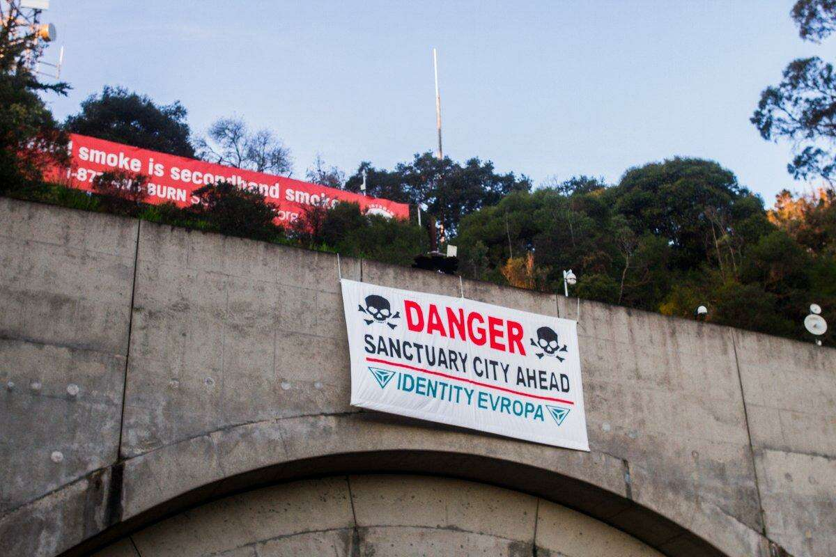 A sign mocking San Francisco's sanctuary city policy was hung early Sunday over the Yerba Buena Island Tunnel in San Francisco.