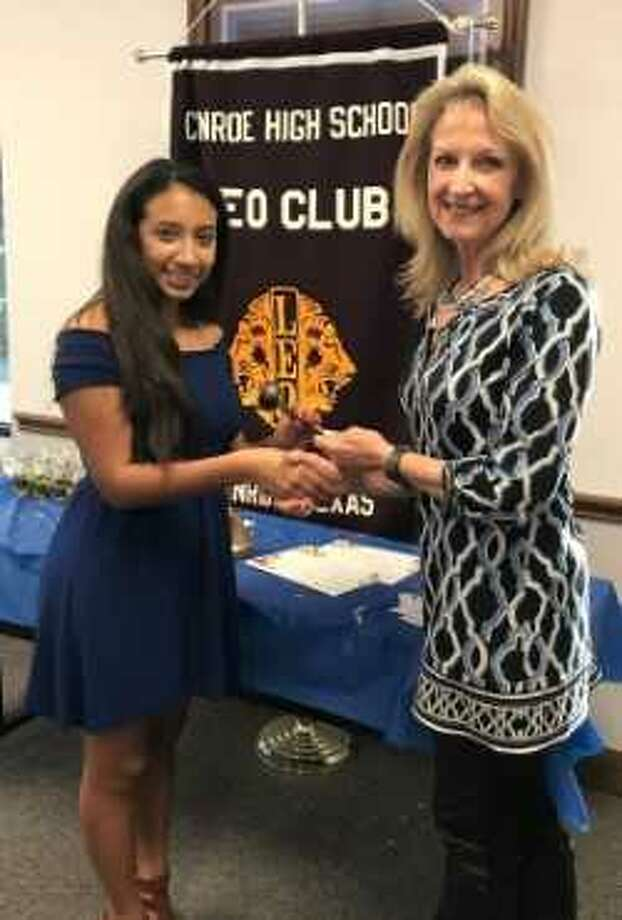 Conroe Noon Lions Club President Helen Thornton hands the gavel to newly installed Conroe High School Leo Club President Kayleigh Martinez during their induction meeting last Wednesday. Photo: Submitted Photo