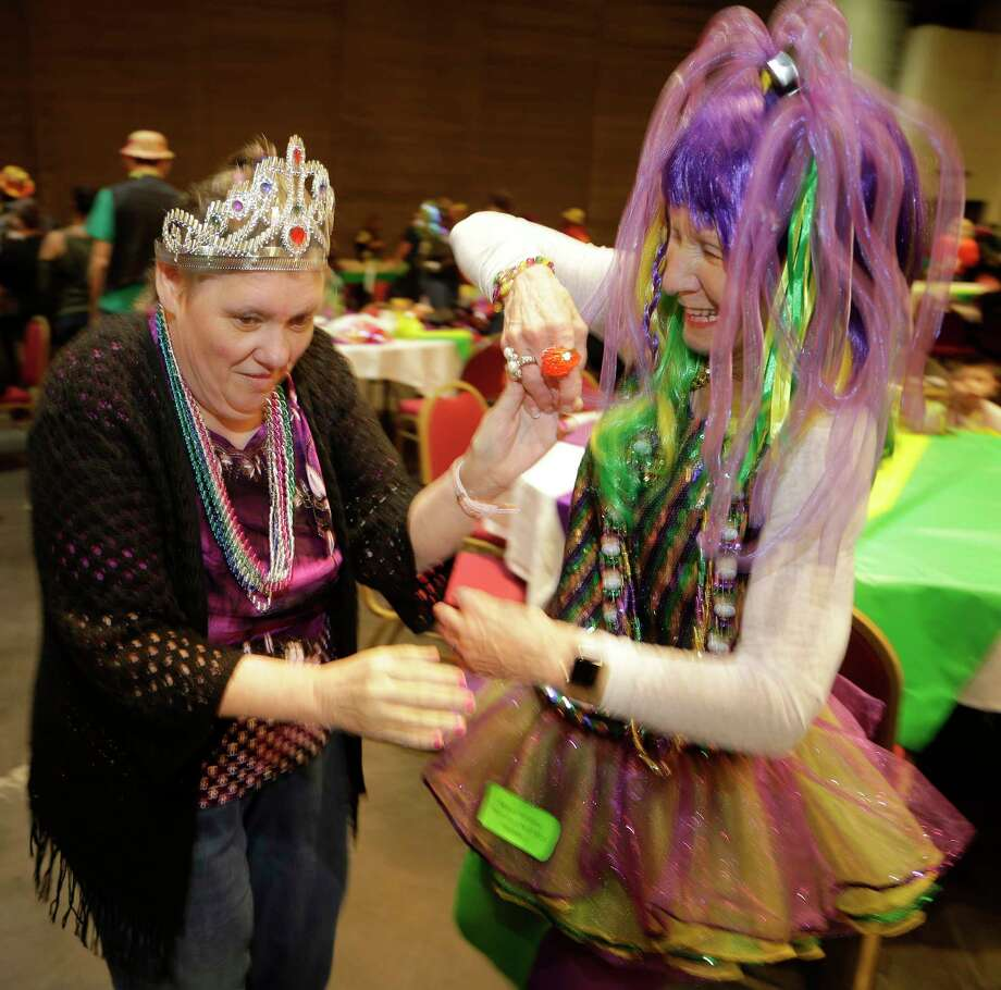 Cheryl Caperton, left, with Vita-Living, dances with volunteer Kathy Lindsey, right, during the annually Mardi Gras Ball for Special People held at Moody Gardens Convention Center Sunday, Jan. 28, 2018, in Galveston. The free event provides food, fun and entertainment for people with special needs and their immediate families. Photo: Melissa Phillip, Houston Chronicle / © 2018 Houston Chronicle