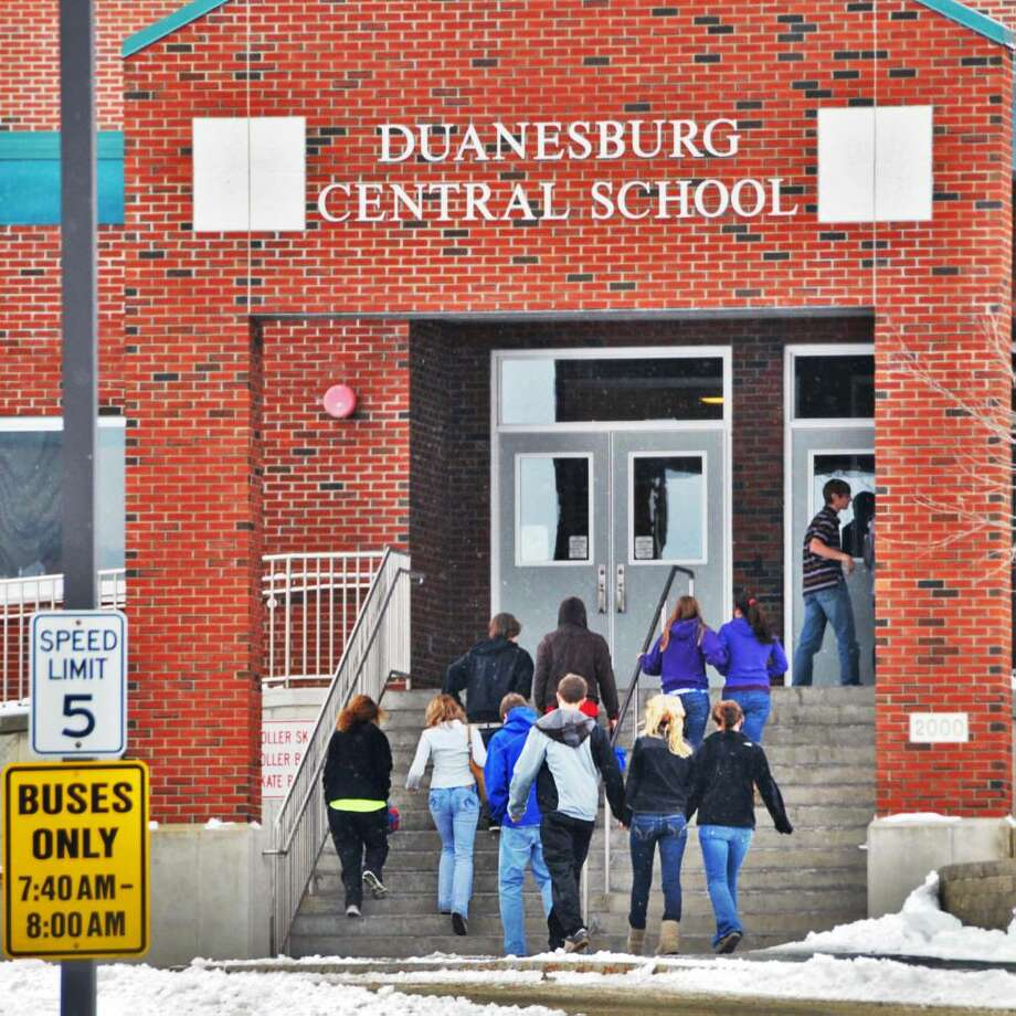 Students enter the Duanesburg Central Junior-Senior High School Tuesday. The school district announced it was the victim of an internet theft  totaling nearly $3 million.  (John Carl D'Annibale / Times Union) Photo: John Carl D'Annibale / 00007059A