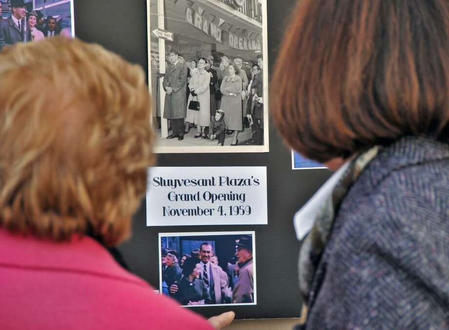 Ann and Carol Swyer, look over a display of historic photographs of Stuyvesant Plaza during a ceremony marking 50th anniversary of the plaza in Albany Wednesday November 4, 2009.  (John Carl D'Annibale / Times Union) Photo: John Carl D'Annibale / 00006249A