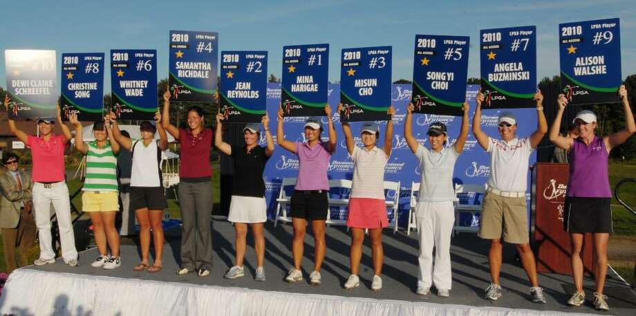 Ten winners hold up their 2010 LPGA player cards following the final round of the Futures Tour championship at Capital Hills Golf Course.  (Luanne M. Ferris / Times Union) Photo: LUANNE M. FERRIS / 00005370B
