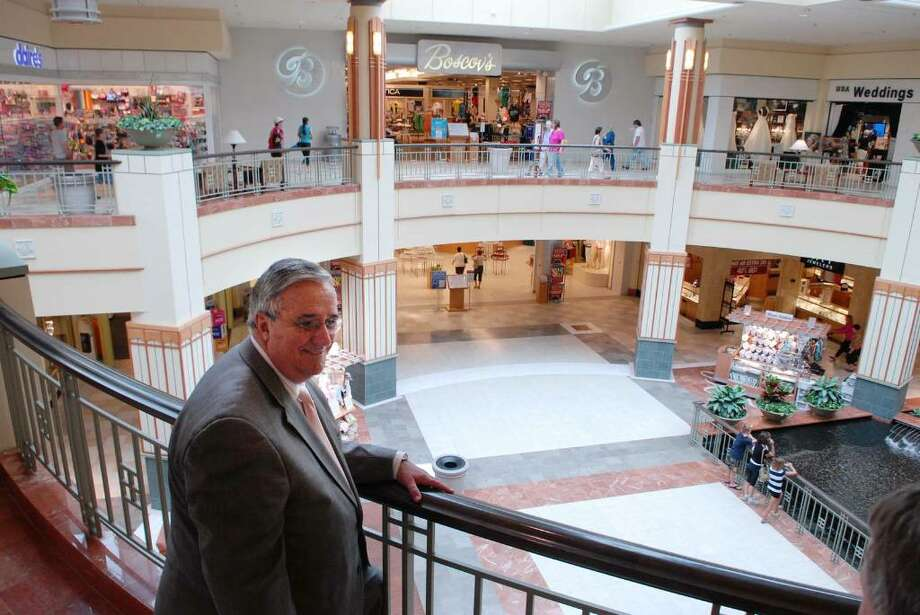 Joseph Millett, general manager for Colonie Center Mall, stands on the second level  at Colonie Center Mall in Colonie, NY on Tuesday, July 21, 2009.  (Paul Buckowski / Times Union) Photo: PAUL BUCKOWSKI / 00004782A