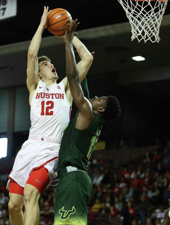 Houston Cougars guard Wes VanBeck (12) goes for a lay up while South Florida Bulls guard Justin Brown (13) is trying to stop him during the second half of the American Athletic Conference game at H&PE Arena on Sunday, Jan. 28, 2018, in Houston. The Houston Cougars defeated the South Florida Bulls 63-40. Photo: Yi-Chin Lee, Houston Chronicle / © 2018  Houston Chronicle