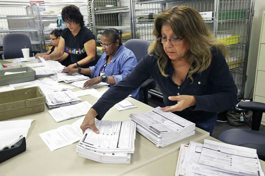 Bexar County Election Department employees process mail ballots, voter registrations, and applications for mail ballots on October 14, 2016.  Processing applications for ballots are (from left) Ruth Ann Luna, Mary Cornejo, Elizabeth Keith and Alice Jimenez (foreground). Photo: TOM REEL, STAFF / SAN ANTONIO EXPRESS-NEWS / 2016 SAN ANTONIO EXPRESS-NEWS