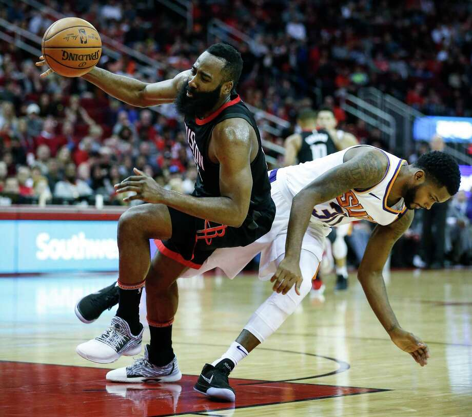 Houston Rockets guard James Harden (13) and Phoenix Suns guard Troy Daniels (30) collide on a pass to Harden during the second quarter of an NBA basketball game at Toyota Center on Sunday, Jan. 28, 2018, in Houston. ( Brett Coomer / Houston Chronicle ) Photo: Brett Coomer, Staff / © 2018 Houston Chronicle