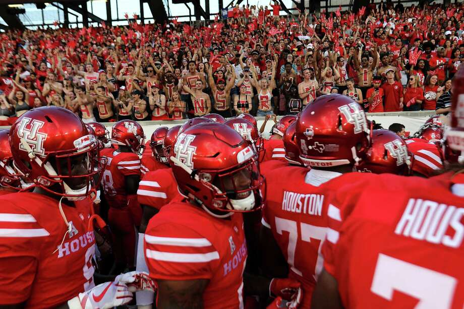 """Houston Cougars leave the field after their """"Cave Sway"""" in front of the student section befoer their game against Rice University at TDECU Stadium on Saturday, Sept. 16, 2017, in Houston. ( Elizabeth Conley / Houston Chronicle ) Photo: Elizabeth Conley, Staff / © 2017 Houston Chronicle"""