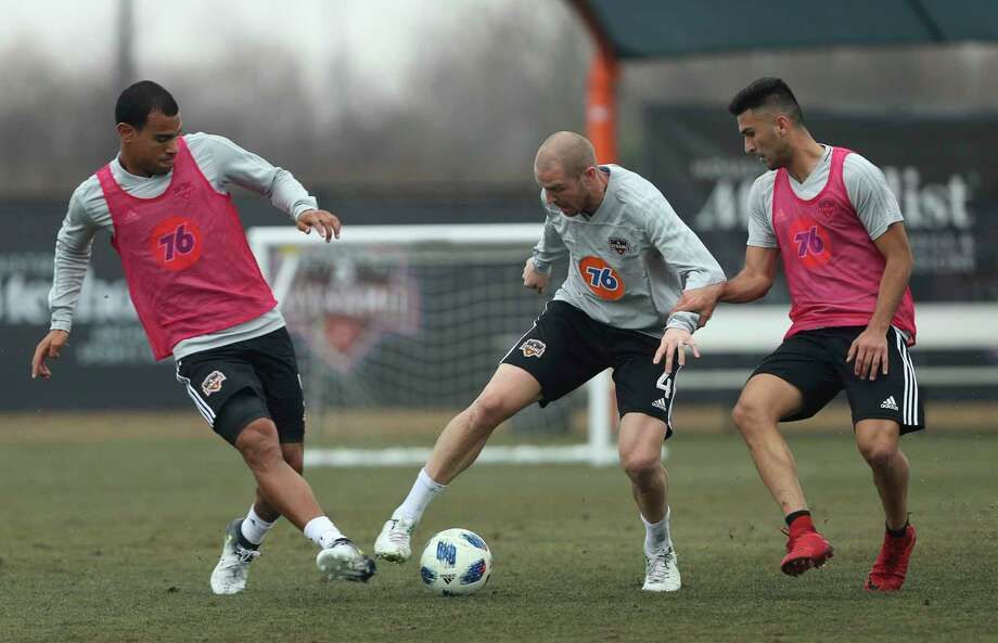 Dynamno's Philippe Senderos (4) battles with other players for control of the ball during the open practice day for fans at Houston Sports Park on Saturday, Jan. 27, 2018, in Houston. Photo: Yi-Chin Lee, Houston Chronicle / © 2018  Houston Chronicle